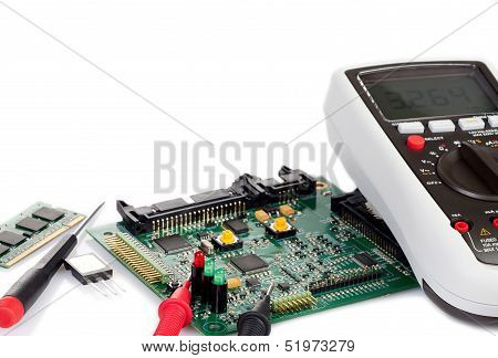 Digital Multimeter And A Circuit Board