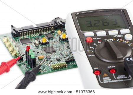 Digital Multimeter And A Circuit Board