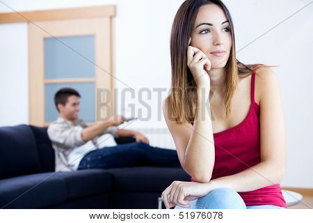 Pretty Young Woman Bored At Home
