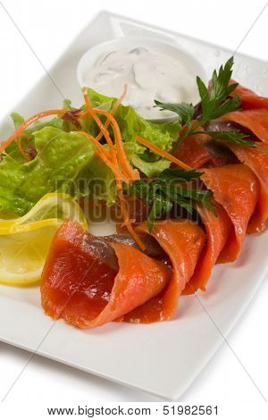 Sockeye salmon in spicy brine, lemon and salad.