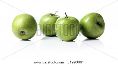 A few green apples over a white background