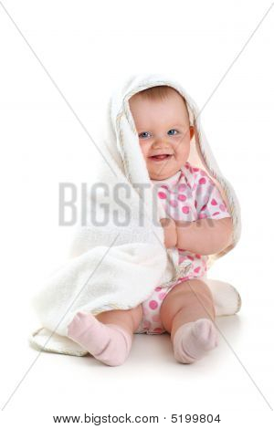 Cute Baby Smiling While Playing With Towel Isolated Over White