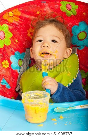 Messy Baby Eating Puree