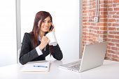 Business Woman On A Cell Phone And Laptop