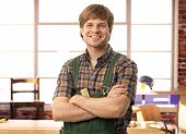 picture of carpenter  - Happy young handyman carpenter in workshop - JPG