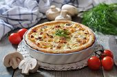 picture of french pastry  - Traditional french quiche pie with chicken and mushroom on a plate