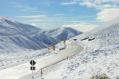 pic of snowy-road  - Road Through Snowy Mountains - JPG