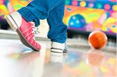 pic of bowling ball  - Young man in bowling alley having fun - JPG