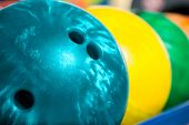 picture of bowling ball  - Colorful bowling balls in front of the tenpin alley - JPG
