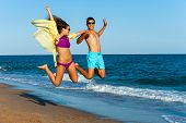 Crazy Couple Jump On Beach.