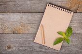 picture of recipe card  - Blank notepad for copy space and basil leaves on wooden table - JPG