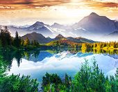 stock photo of sunny season  - Fantastic sunny day is in mountain lake - JPG