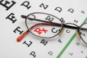 pic of snellen chart  - snellen eye chart with prescription symbol and glasses - JPG