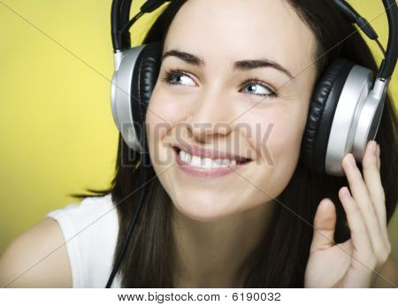 Beautiful Young Girl Enjoys Listening To Music