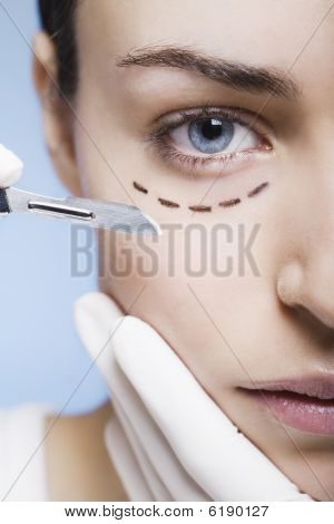 Cosmetic Surgery With Scalpel On A Young Woman