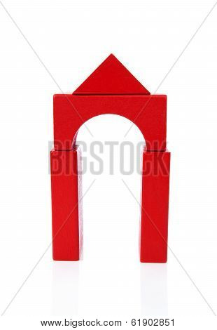 House Made Out Of Red Wooden Building Blocks Over White Background