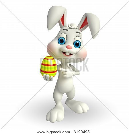 Cute easter bunny with big colorful egg