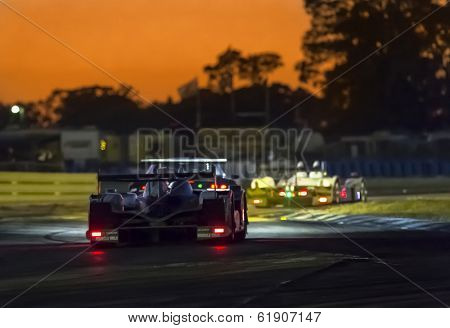Sebring, FL - Mar 13, 2014:  The Muscle Milk Pickett Racing Oreca takes to the track for a night practice for the 12 Hours of Sebring at Sebring International Raceway in Sebring, FL.