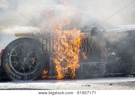 Sebring, FL - Mar 15, 2014:  The Riley Motorsport Dodge ViperExchange.com goes up in flames after a crash early in the 12 Hours of Sebring at Sebring International Raceway in Sebring, FL.