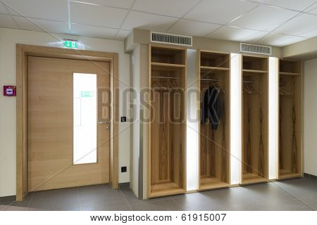 wooden illuminated wardrobe  with clothes hanger