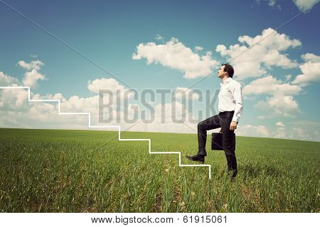 Businessman In White Shirt Walks Up The Ladder
