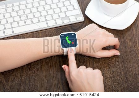 Female Hands With Smartwatch With Phone Call On The Screen In An Office
