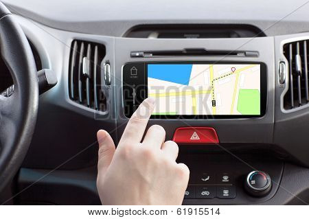Man Sitting In A Car And Touching Play Finger In A Navigation Map
