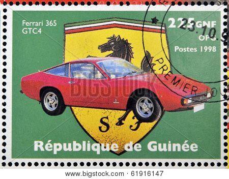 GUINEA - CIRCA 1998: Stamp printed in Guinea dedicated to anniversary of Enzo Ferrari shows Ferrari