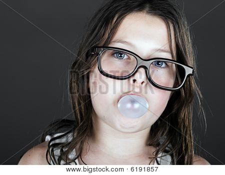 Cute Child Geek Blowing A Bubble