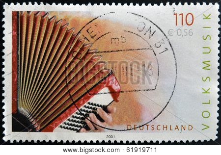 GERMANY- CIRCA 2001: stamp printed in Germany dedicated to Folk Music shows accordion circa 2001.