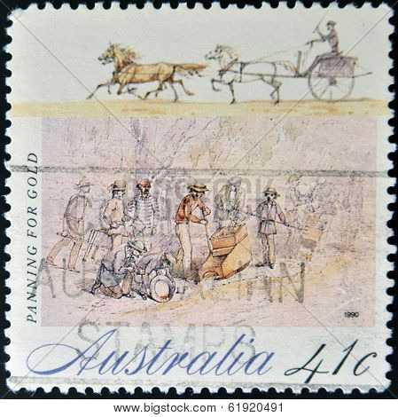 AUSTRALIA - CIRCA 1990: A Stamp printed in Australia shows the Panning for Gold circa 1990