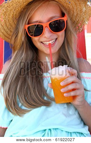Beautiful Girl In Sunglasses And Slush On Beach