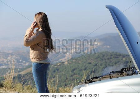 Woman On The Phone Asking For Assistance Beside Her Crashed Breakdown Car