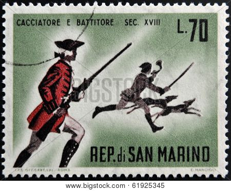 SAN MARINO - CIRCA 1961: A stamp printed in San Marino dedicated to hunting shows hunter and beater