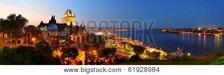 Quebec City skyline panorama with Chateau Frontenac at dusk viewed from hill