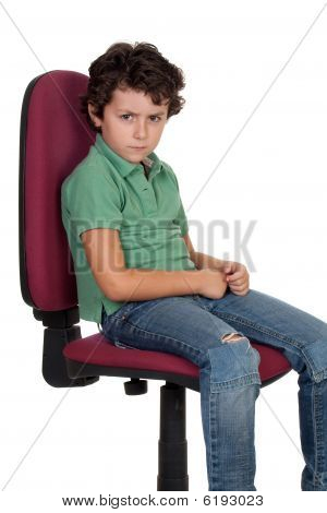 Angry Little Boy Sitting On Big Chair