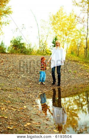 Mother And Son Near The Lake