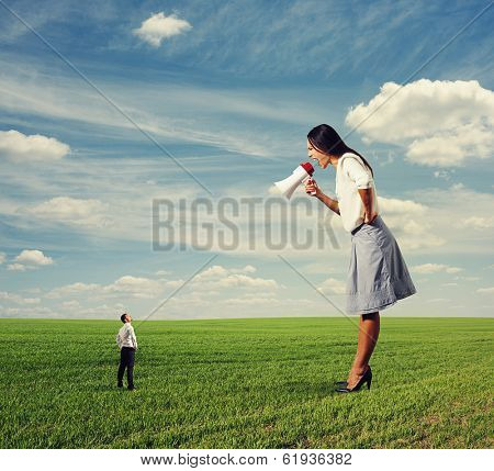 big angry woman and small man on the field