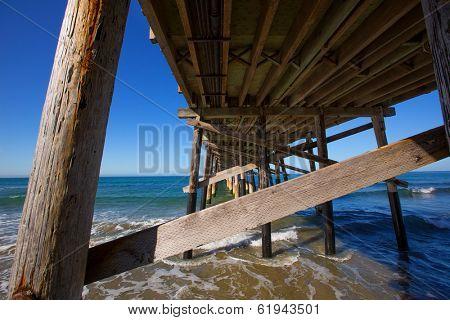 Newport pier beach in California USA seen from below