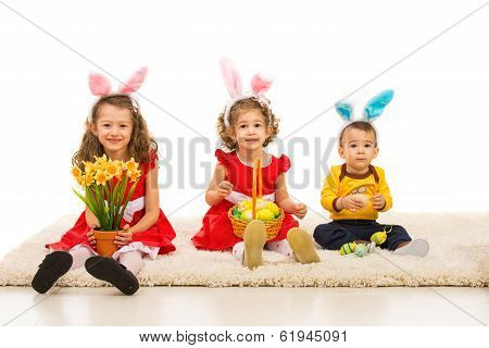Three Kids With Bunny Ears In A Row