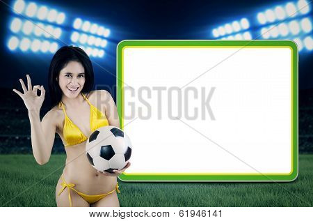Woman with soccer ball and copy space