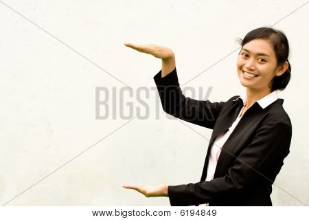 Businesswoman Showing Height With Her Hands