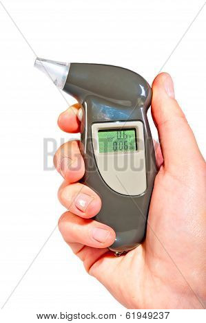 Breathalyzer In A Female Hand Showing Drunkenness