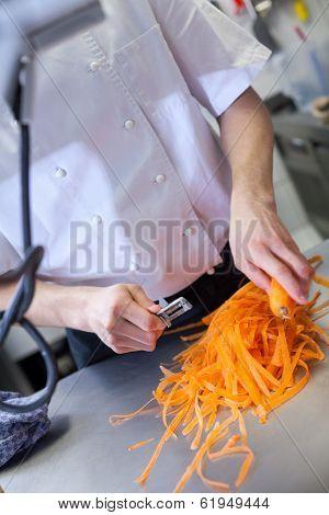 Chef In Uniform Preparing Fresh Carrot Batons