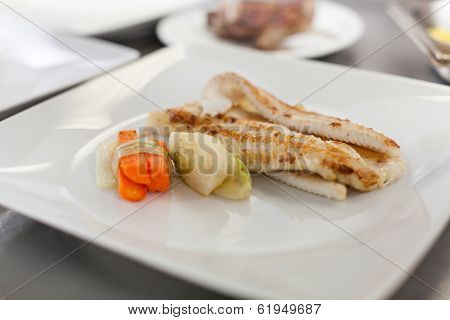 Fried Fish Fillets And Vegetables