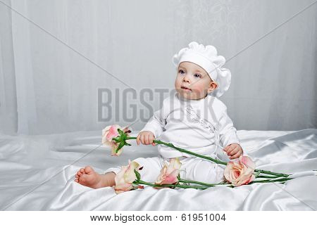 Little Girl And Flowers