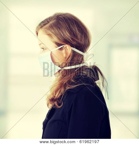 Woman wearing a mask to prevent flu infection.