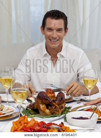 Smiling Man Eating Turkey In Christmas Dinner