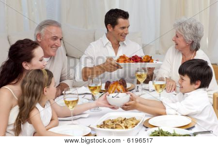 Family Having A Big Dinner At Home