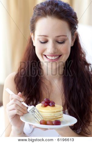 Smiling Woman Eating A Sweet Dessert